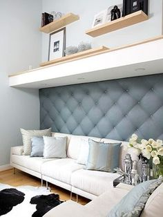 """Fashionable upholstered walls in Parisian salons inspired freelance fashion and interior designer Kerri Gutekunst and her husband, Brent, to create their own """"padded room."""" After a vacation to the haute couture mecca, Kerri whipped up this luxury treatment for the den of their San Diego home."""
