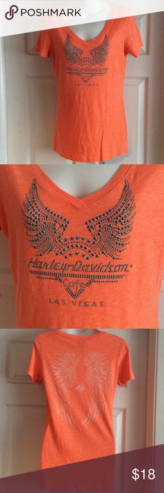 Orange short sleeve Harley Davidson Sz M Harley Davidson orange short sleeve t-shirt. Stud style beading on front that changes color when moving. Angel wing design on back. This is a size medium. It comes from themHarley Davidson Cafe in Las Vegas. Harley-Davidson Tops Tees - Short Sleeve