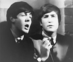 """onlypaulmccartney: """"have some classic john lennon staring intensely at paul mccartney during an interview """"november 1, 1963 """" """""""