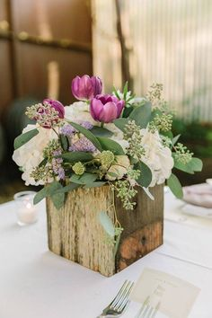 boxed centerpiece with white hydrangeas and purple tulips