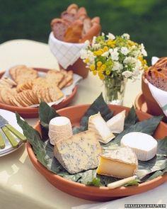 Flowerpot Servers  Match the informality of a summer buffet with rustic serving dishes fashioned from clay flowerpots and saucers
