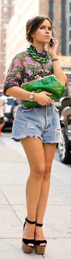 So basically this is a picture of a chick in her husband's shorts and her grandmother's blouse?  And possibly her mother's platforms from the 70's??? Way to recycle!