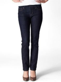 """Minimize your midsection. Classic slight curve slim cut jeans. Look For: Stiff, not stretchy, denim. These 99% cotton classics won't cling or create the dreaded """"muffin top"""" that more elastic denim does.   Look For: Mid-waisted jeans. Avoid: Falling into the """"these jeans are like Spanx!"""" trap. The higher the cotton content, the better.  Avoid: Bold buttons or embellishments at the front pockets."""