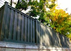 want to put your fence on a concrete wall? take a look at this Winchester Grey Trex Fence line on top of concrete! Trex Fencing, Fence, Concrete Wall, Winchester, Yard, Landscape, Grey, Outdoor Decor, Gray