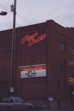 Mission Theater & Pub neon sign & brick building in Portland, OR