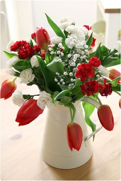 """Red tulips, white and red carnations, and baby's breath. There was an arrangement like this in """"One Trick Pony. Red And White Flowers, Red Tulips, Tulips Flowers, Fresh Flowers, Beautiful Flowers, Carnations, Beautiful Flower Arrangements, Floral Arrangements, Red Carnation"""