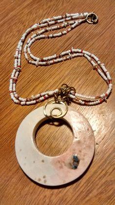 Handmade necklace, in whit ceramic and shakiras.  CRIVÁT... FER
