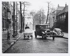 Taxi passing a tricycle of the Dutch Post Office, November 27 1952.