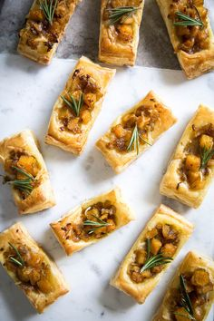 These Pumpkin & Rosemary Puff Pastry Bites are incredibly easy to pull together and make for the perfect bite-sized fall appetizer.