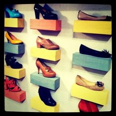 A friend of mine took a photo of this Anthropologie shoe display, and using shoe boxes, made the coolest display of her own shoes all along her bedroom wall.  The mate to each display shoe was in the box.  She used Hercules Hooks (I don't know exactly how...) to keep the shoe boxes up.  It is cool.