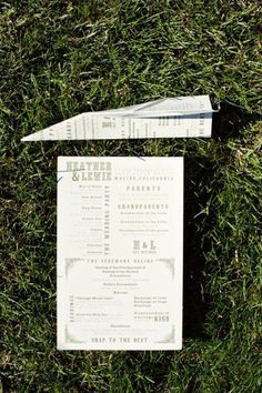 This couple met on an airplane, so they made paper airplanes out of their wedding programs!