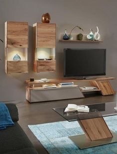 Living wall in mud colors, book colorscolors Wall Unit Designs, Living Room Tv Unit Designs, Tv Unit Furniture Design, Living Room Tv Cabinet, Tv Stand Decor, Modern Tv Wall Units, Tv Cabinet Design, Tv Wall Decor, Living Room Decor Inspiration