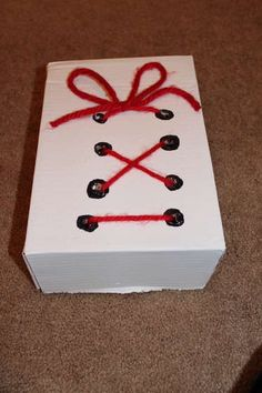 Use a Box To Practice Tying Shoes and Making Bows - Good for fine motor skills, hand-eye coordination.