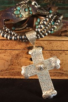 More Navajo Pearls with a silver cross pendant.
