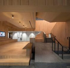 The main body of this office staircase is constructed from light ash wood, although the treads are made from a fine-aggregate concrete.