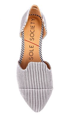 Black & white stripe d'Orsay flat with a pointed toe and an elastic detail at back heel to keep foot in place. Bound to be worn all day, every day.