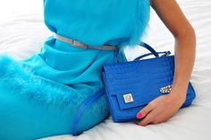 Turquise dress. Blue bag. Pink nails.