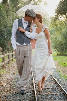 Railroad tracks, umbrella, and a dashing young gentleman? I don't think it can get much cuter than this.                                                                                                                                                     Más
