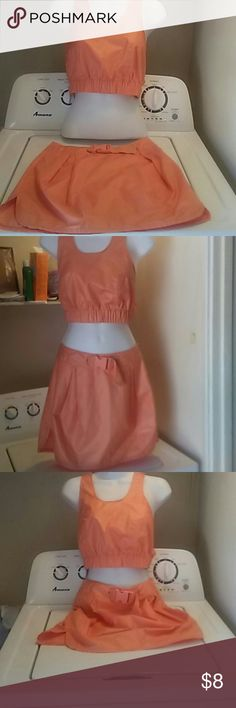 Two piece tangerine set Sexy 100 % polyester top and matching bottom traditional orange color. A/X Armani Exchange Skirts Mini
