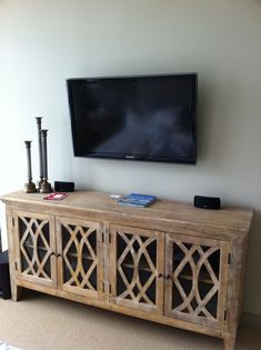 what to put under wall mounted tv found on home inspiration. Black Bedroom Furniture Sets. Home Design Ideas