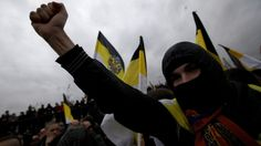 Ultra nationalist demonstrators and activists shout anti-government slogans as they march to mark National Unity Day, in Moscow, on Sunday, Nov. 4, 2012. (AP / Ivan Sekretarev)