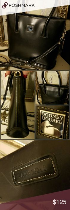 Dooney & Bourke Parasole Bag Vintage and rare. The Parasole line has rubber  bottoms. Very sturdy leather. In excellent condition. Smaller crossbody type bag. Trade value 200.00 Dooney & Bourke Bags