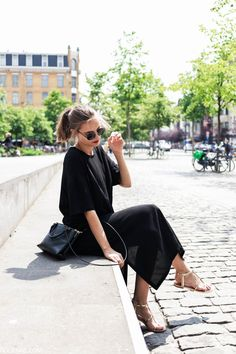 Paulien Riemis is wearing a sheer black dress and gold sandals! Dress: H&M, Shoes: What For