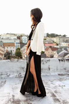 Skirt With A Thigh High Slit:Krystal Bick is wearing a satin black maxi skirt with a thigh high slit