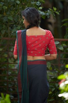This black saree ending in a red woven border and green edging was woven at a village co-operative society in Kerala. This saree has been designed based on a...