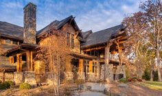 This upscale western style home in Burr Ridge, IL, is just as stunning on the inside, as it is the outside. Click through to see gorgeous photos. #burrridge #western #rusticdesign
