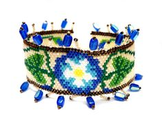 https://flic.kr/p/7L8SyS | Morning Glory Flower Delica Beaded Bracelet | Bracelet measures about: 1.5 inches (including the beads on each sides) x 6.8 inches not including beaded clasp  Made Using: Peyote stitch  Main Colors: Creme  This was designed by Sigrid Wynne-Evans and made by me.