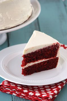 "Moist Red Velvet Cake with Tangy Cream Cheese Frosting. ""This recipe is a keeper. Amazing flavor, and very moist! I made it with the real red velvet cooked icing. Delicious!"""