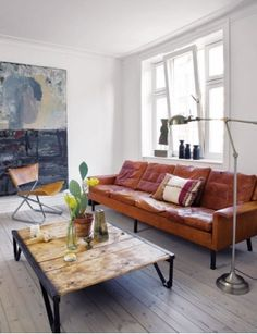 Very cool living room, great wall painting  original colors