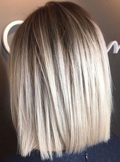 Shoulder length blunt long bob. Ice blond lob.