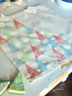 stamp a pattern with triangle sponges