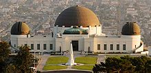 Griffith Observatory in Los Angeles, California.  The observatory was featured in two major sequences of the celebrated James Dean film Rebel Without a Cause (1955); a bust of Dean was subsequently placed at the west side of the grounds.