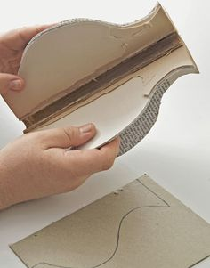 Step 4: Cut off the book's covers and remove the template. Then open the book and fold it backward, before gluing the back pages together with a glue gun.   - CountryLiving.com