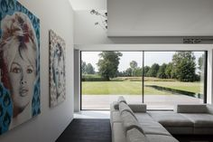 Minimal windows to rear living room, being used as modern patio doors by IQ Glass.