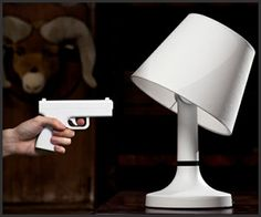 BANG! Lamp  The gun is a remote that will, when pointed and shot at the lamp, turn it off and make it move as if it were actually shot. I want it.