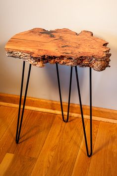 This cherry burl end table measures approximately 15 by 20 inches and is 24 inches high. Table top thickness is 2 inches. This piece has the rich