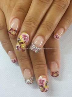 One stroke flower nail art with swarovski crystals and sponging