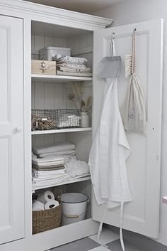 A cupboard like this would be great for storing extra paper towels, toilet paper, cleaning products, etc... (in pretty baskets and bins, of course!)