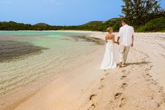 What would you like to do after your wedding? How about a stroll on the beach?  #ST-Thomas-wedding