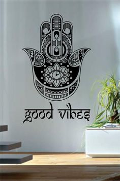 "Good Vibes Hamsa HandThe latest in home decorating. Beautiful wall vinyl decals, that are simple to apply, are a great accent piece for any room, come in an array of colors, and are a cheap alternative to a custom paint job.Default color is blackMEASUREMENTS:28"" x 18 1/2""   About Our Wall Decals:* Each decal is made of high quality, self-adhesive and waterproof vinyl.* Our vinyl is rated to last 7 years outdoors and even longer indoors.* Decals can be applied to any clean, smoo..."