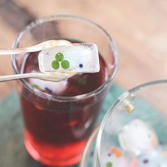 Make fun ice cubes with edible confetti! Punch confetti from thin sliced carrot, cucumber peel, red cabbage and fill an ice tray