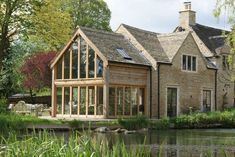 An oak wood and glass extension in Cirencester, Cotswolds. An oak wood and glass extension in Cirenc Oak Framed Extensions, House Extensions, Style At Home, Cottage Extension, Oak Framed Buildings, Oak Frame House, Glass Extension, Building Extension, Dream House Exterior