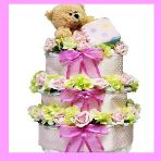 I love the silk flowers on this diaper cake! http://newbabydiapercakes.com/products-page/girl-diaper-cakes/girl-bear-diaper-cake-tower/