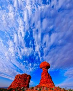 Balanced Rock with cloud formations, Arches National Park, Moab, Utah, USA