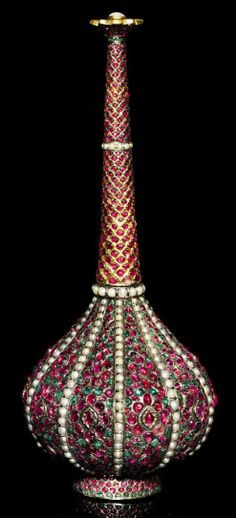A fine Mughal gem-set silver and gold rosewater sprinkler. North India, , 17th/18th century.