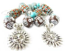 These sun curtain tiebacks are perfect for shabby chic decor in your home. The silver celestial sun pendant is 1 inch wide and hangs from a string of turquoise,